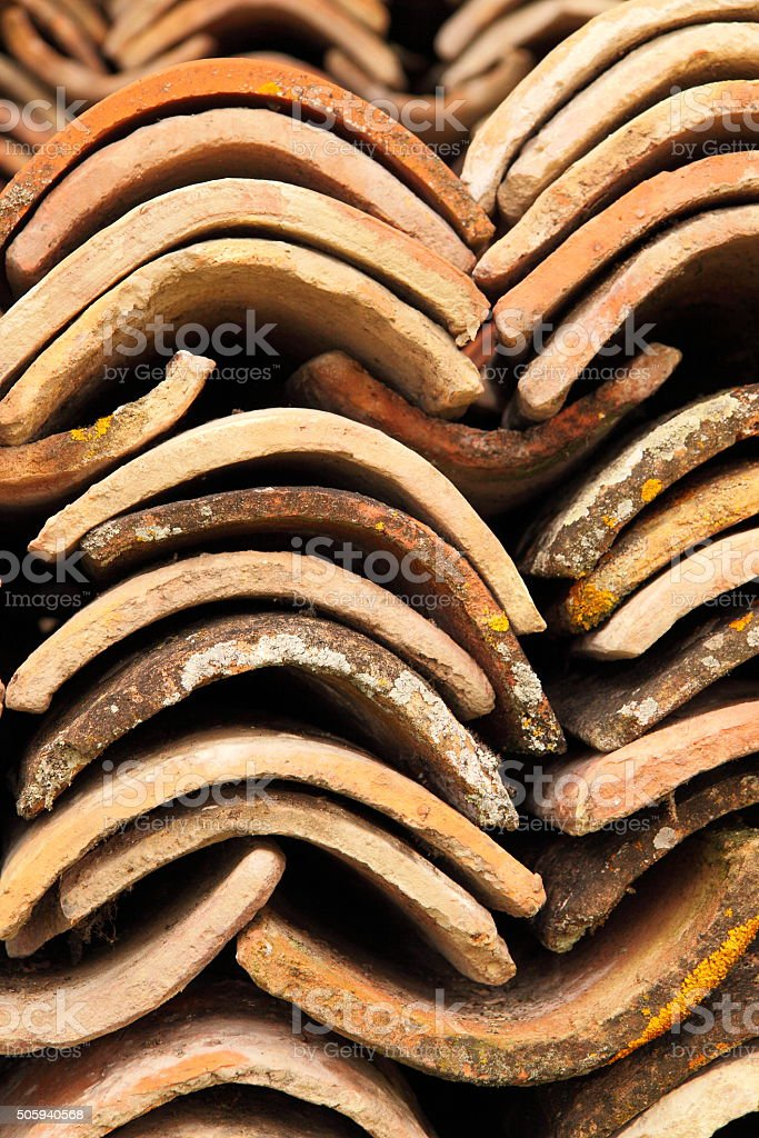 Stacked vintage clay roof tiles on a French construction site stock photo