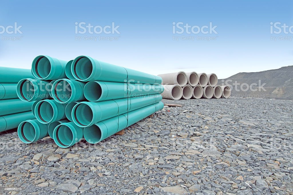 Stacked Water And Sewer Pipe On New Road Construction Site stock photo