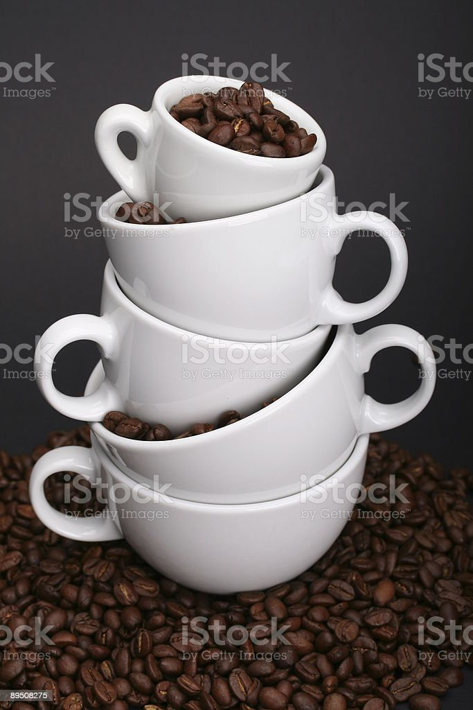 Stacked White Cups and Coffeebeans royalty-free stock photo