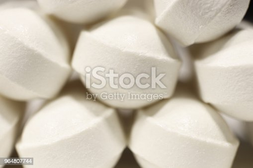 Stacked White Medicine Tablets Pharmacy Pills Background Macro Closeup Stock Photo & More Pictures of Addiction