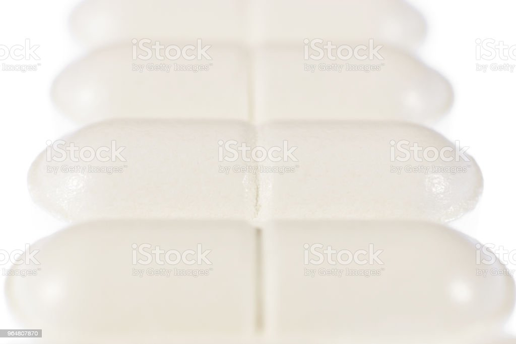 Stacked White Medicine Tablets. Pharmacy Pills Background. Macro Closeup. royalty-free stock photo