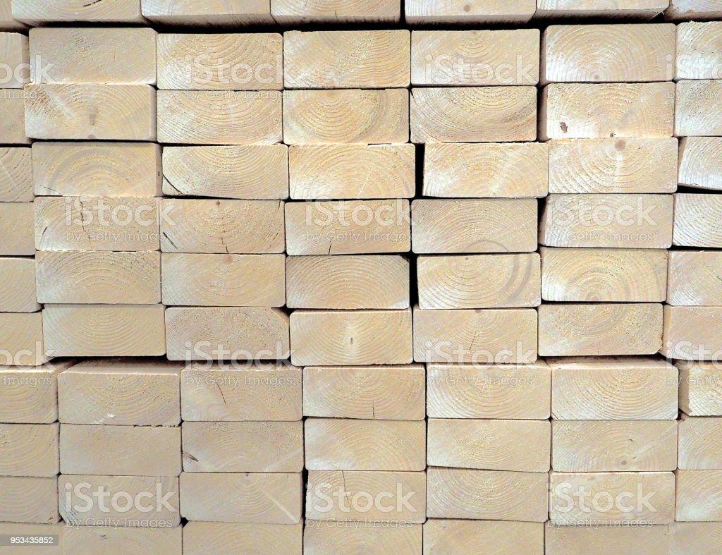 stacked wood 2x4' light construction lumber stock photo