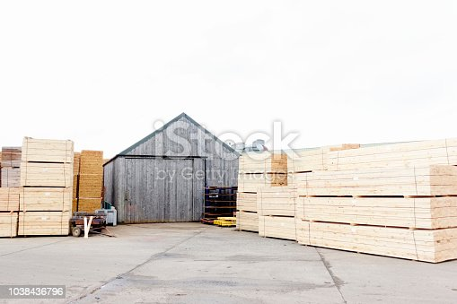 istock Stacked wood stored at sawmill for biomass fuel 1038436796
