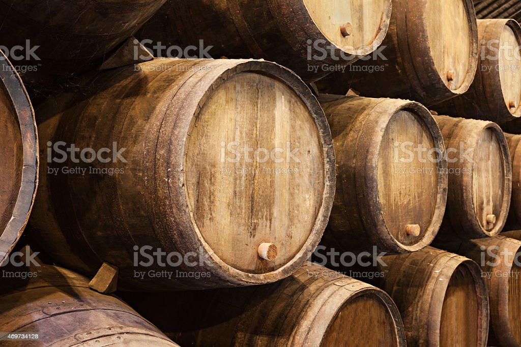 Stacked wooden wine barrels in Porto  stock photo
