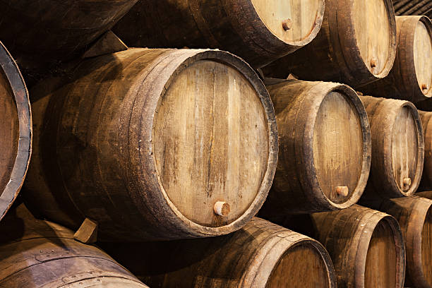 Stacked wooden wine barrels in Porto  Barrels in the wine cellar, Porto, Portugal cellar stock pictures, royalty-free photos & images