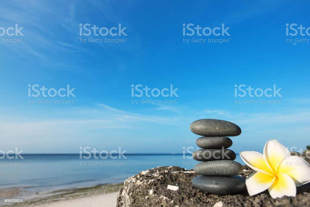 Stacked Zen stones on the beach rock stock photo