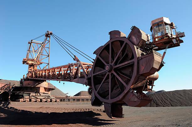 Stacker reclaimer in iron ore shipping yard stock photo