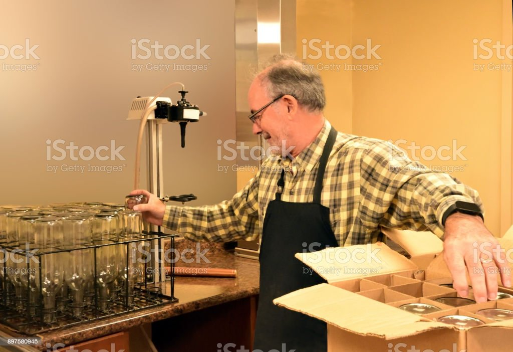 Stacking and Washing Wine Bottles stock photo