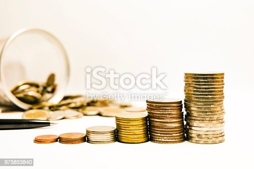 istock Stacking coins money growing increasing on white background 975853840