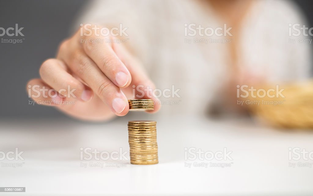 stacking coins stock photo
