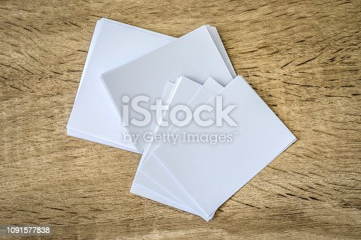968272356istockphoto stacking of a mockup empty white business card  on a wooden background , template for business  branding  design 1091577838