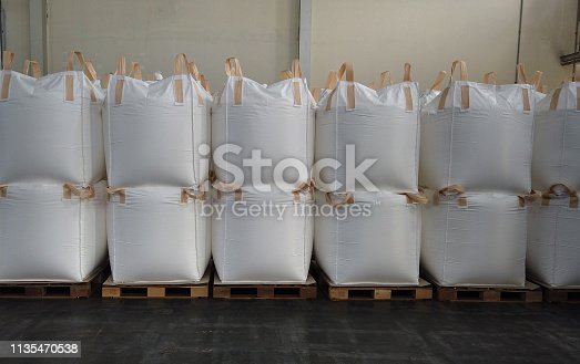 Stacking of bulk cargo in jumbo bags are store in warehouse