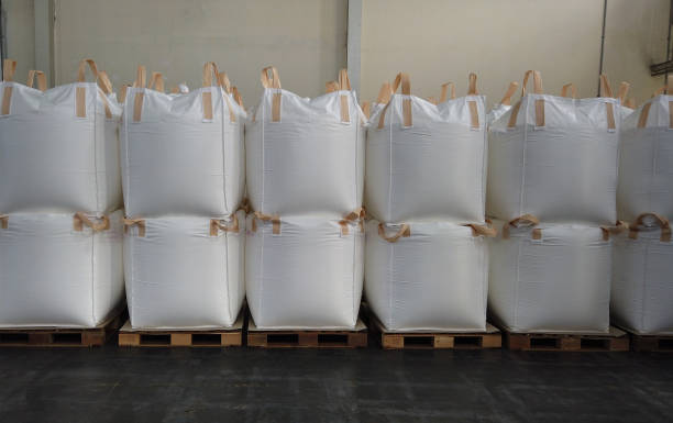 Stacking of bulk cargo in jumbo bags are store in warehouse stock photo