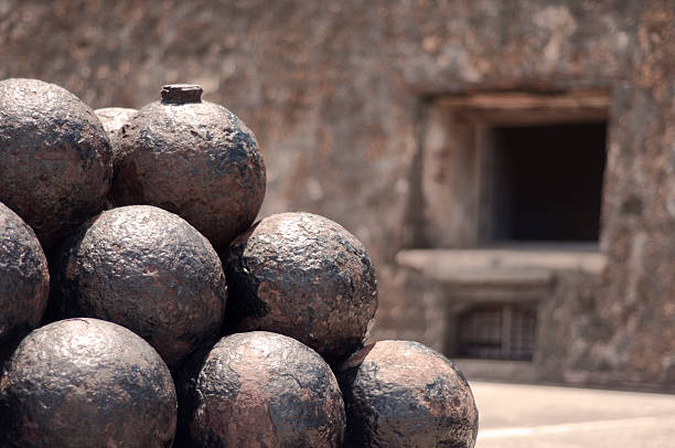 Stacking of cannonballs stock photo