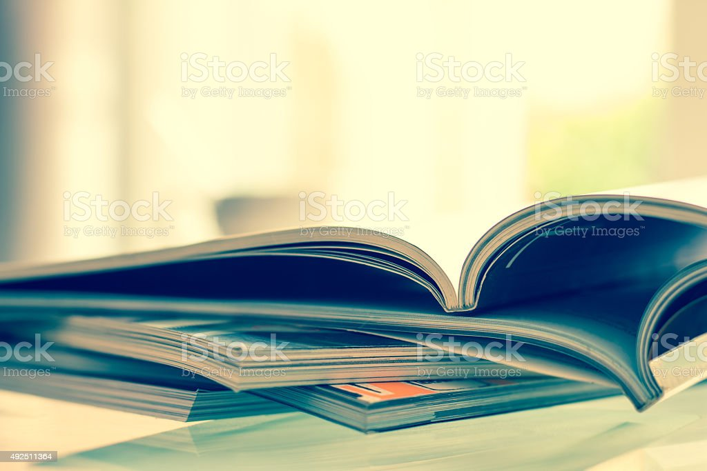 stacking of magazine with extremely DOF , vintage color tone stock photo