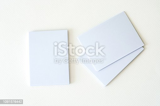 968272356istockphoto stacking of mockup empty white business card  on a white paper background , a template for business  branding identity design 1091576442