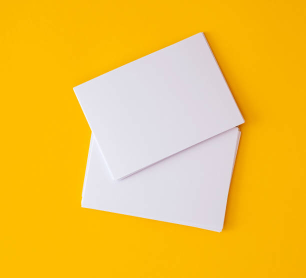 stacking of mockup empty white business card   on vibrant yellow background , template for business  branding  design - postcard template stock photos and pictures