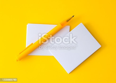968272356 istock photo stacking of mockup empty white business card with elegance pen  on vibrant yellow background , template for a business  branding  design 1205665760