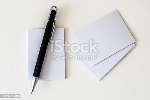 968272356istockphoto stacking of mockup empty white business card with elegance pen  on white paper background , a template for business  branding identity design 962028088