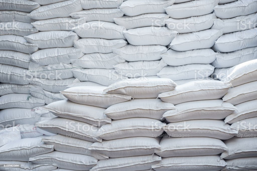 Stacking of wheat bags on truck move to warehouse. stock photo