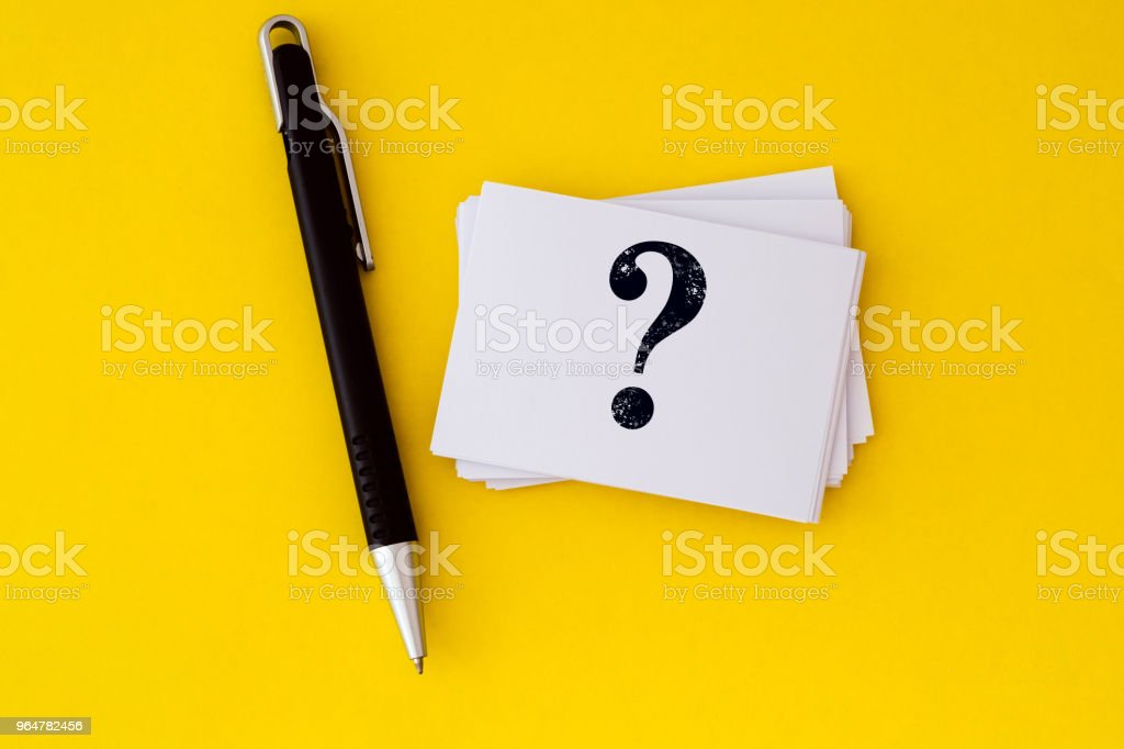 stacking of  white business card with written question mark symbol  on vibrant yellow background , Questions and Answers or Q&A concept design royalty-free stock photo