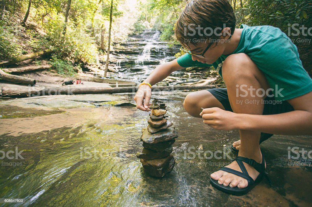 stacking stones at the river stock photo