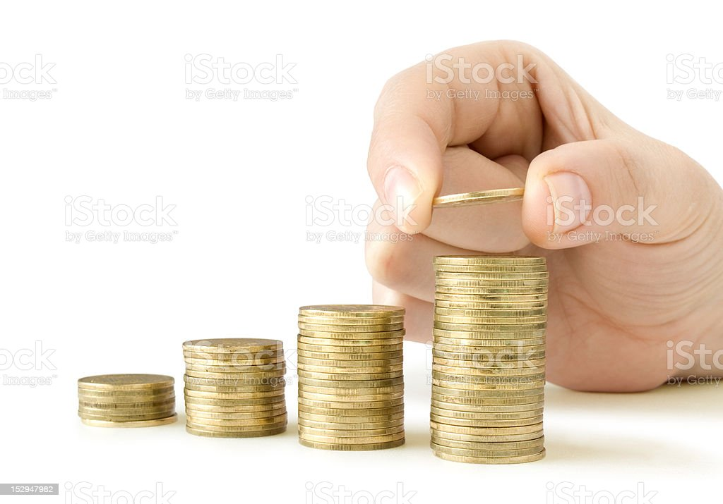 stacks coins like diagram and coin in hand royalty-free stock photo