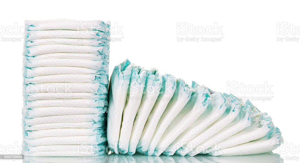 Stacks  diapers for children isolated on white background stock photo