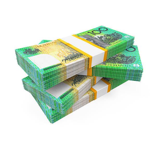 Stacks of 100 Australian dollar banknotes stock photo