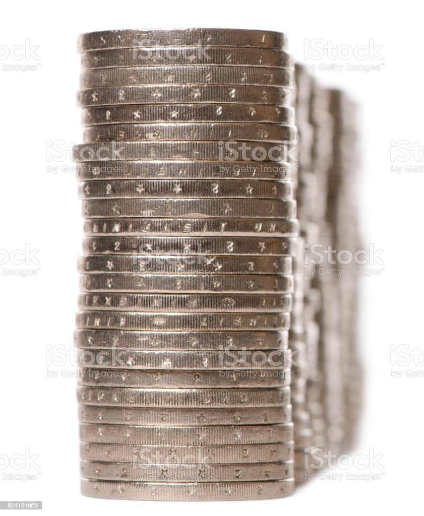 Stacks of 2 Euros Coins in front of white background stock photo