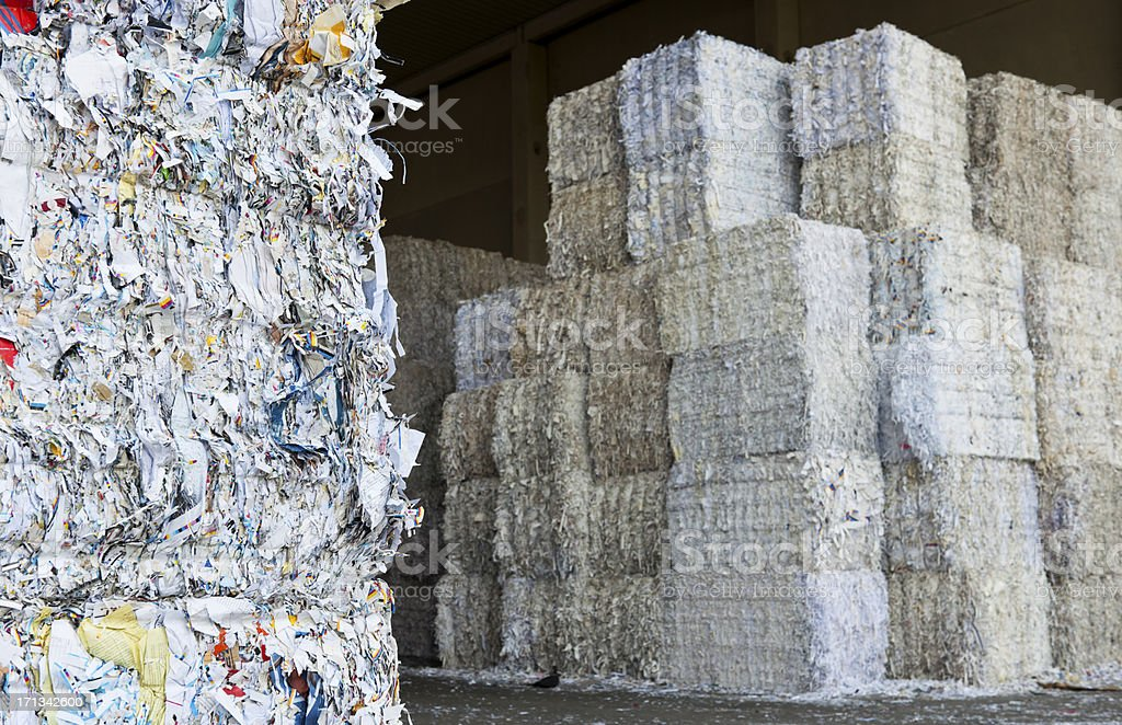 Stacks of baled waste paper in a recycling center stock photo