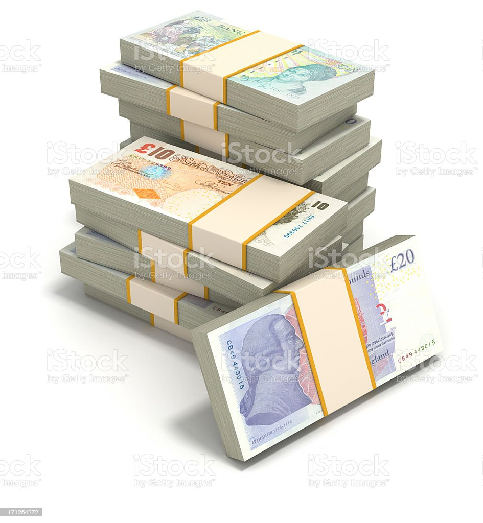 Stacks of British pounds against a white background royalty-free stock photo