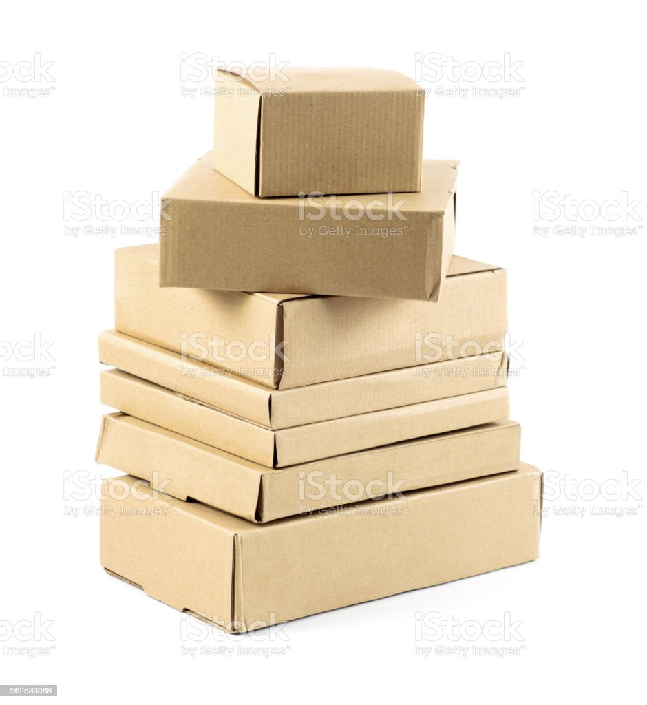 Stacks of cardboard boxes isolated on white background - Royalty-free Box - Container Stock Photo