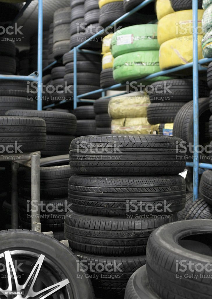 stacks of cars tire in shop storage stock photo
