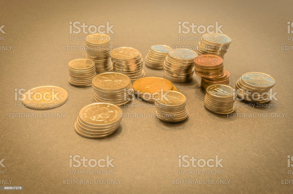 Stacks of coins in a mystical setting with a golden hue stock photo