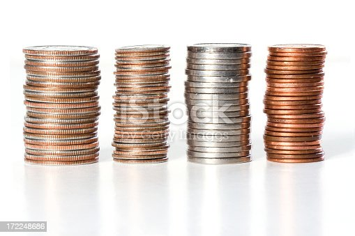 Horizontal closeup of four stacks of coins on white background, including quarters, dimes, nickels and pennies.