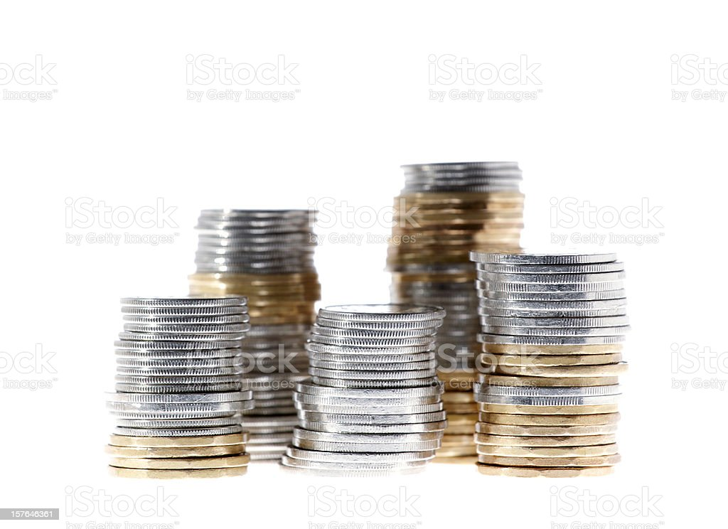 Stacks of coins of various valued stock photo
