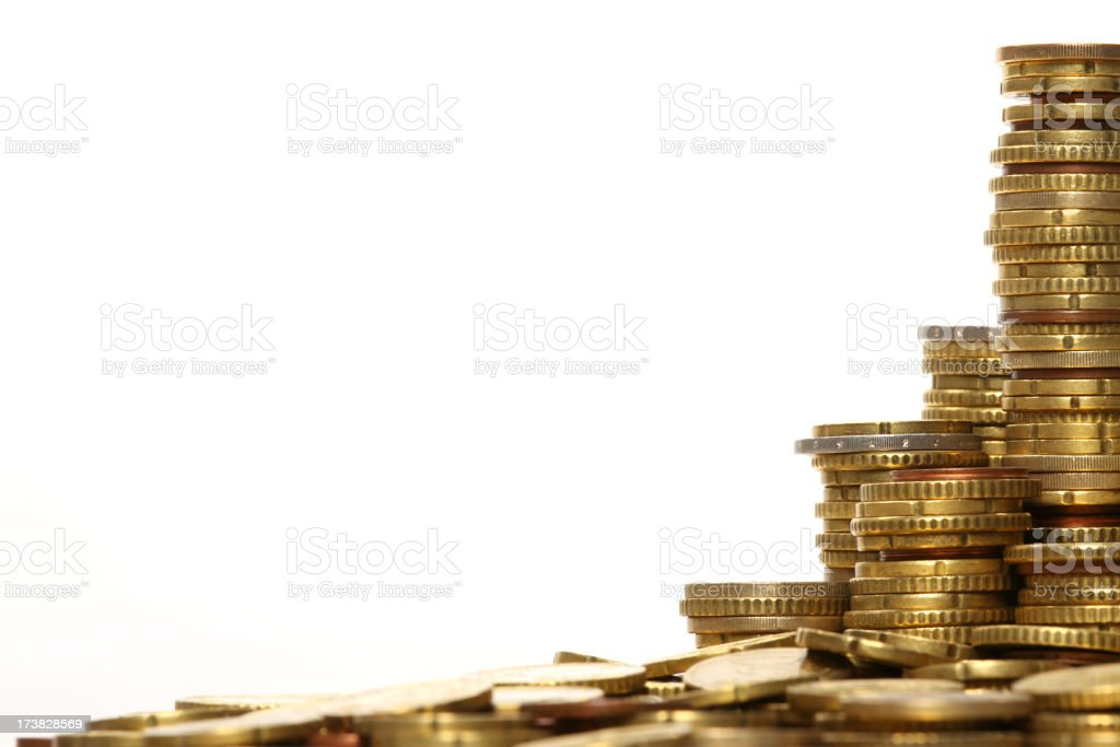 Stacks of coins on white background royalty-free stock photo