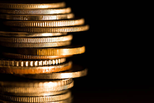 stacks of coins - coin stock photos and pictures