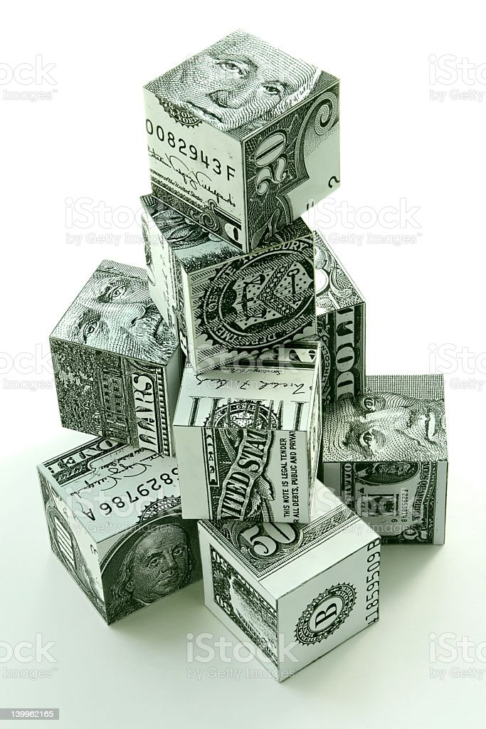 Stacks of cubes made out of American money royalty-free stock photo