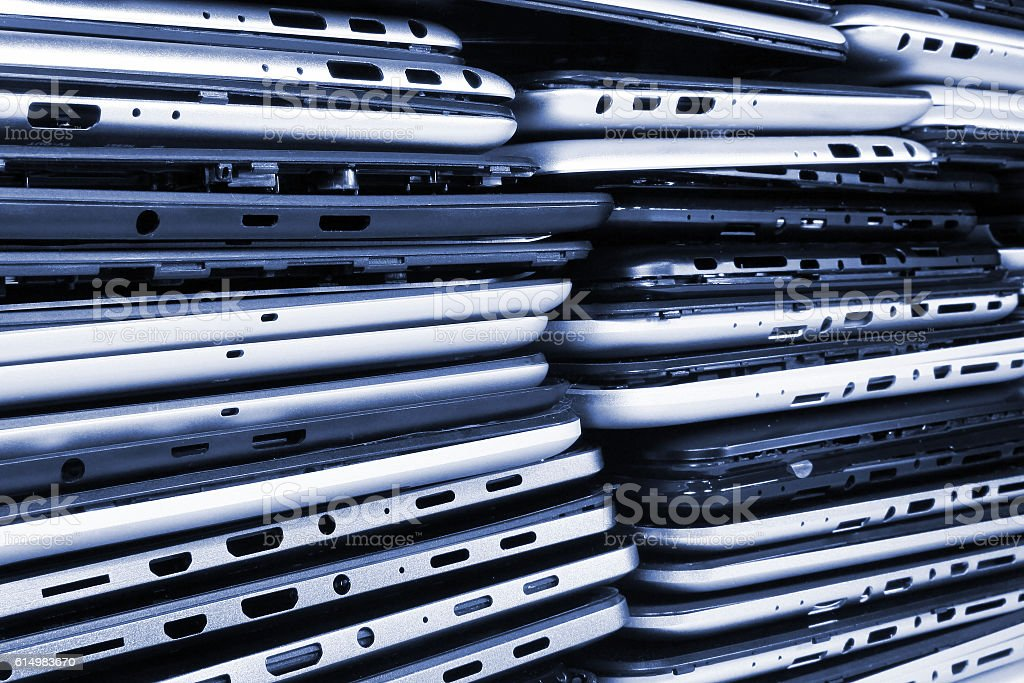 Stacks of disassembled tablets and smartphones stock photo