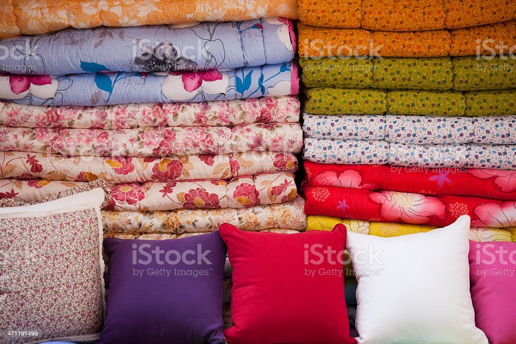 Stacks of Duvet Fabric at Outdoor Flea Market Stand royalty-free stock photo