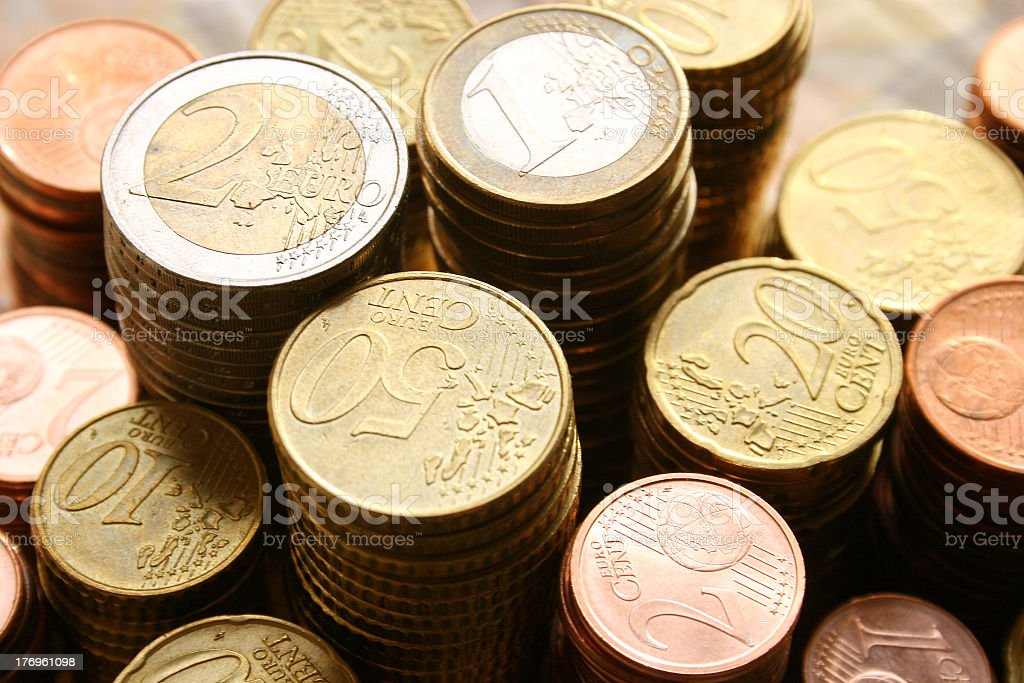 Stacks of Euro coins of different denominations stock photo