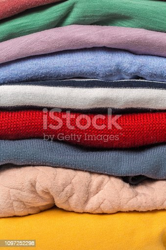186826582 istock photo Stacks of folded clothes, close up 1097252298
