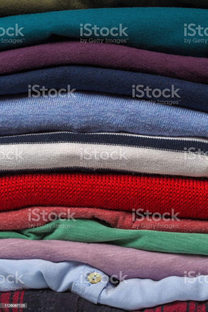 Stacks of folded clothes, close up