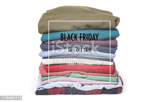 186826582 istock photo Stacks of folded clothes on white background. Black friday sale 1184831113