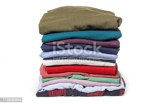 186826582 istock photo Stacks of folded clothes on white background 1126063845