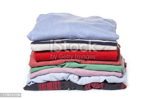 186826582 istock photo Stacks of folded clothes on white background 1126141759