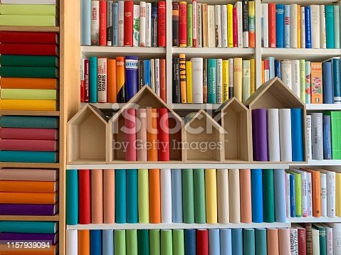 Stacks of generic books in front of library