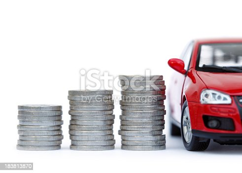 Coin rolls and a red car, isolated on white background.